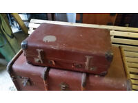 Small vintage leather suitcase with adjustable hinges