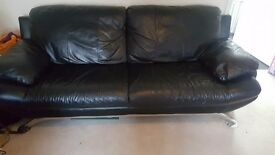 Black Leather suite 3 seater & 2 seater with chrome frame and legs.