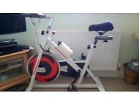 Exercise bike and floor protector mat