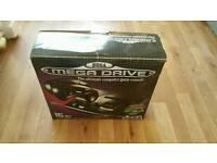 Boxed Mega Drive. Near new condition.