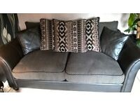 Large brown/light brown 3-4 seater fabric and leather sofa.