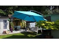 overhanging parasol with 4 support bases pieces