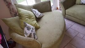 Three seater & cuddler sofa pillow back lime green..Corinne range from DFS