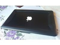 Metallic Black Macbook Air 11 inch purchased Sept. 2016 with Thule Vectros Case