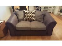 Two seater charcoal sofa with cushions
