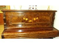 Upright piano and stool for sale.