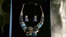 Costume jewellery silver and blue necklace and earring set
