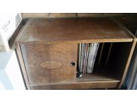 100 Vinyl Records and cabinet give away. Classic records and pop songs. Wooden showcase holder