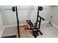 Mirafit adjustable squat rack, bench, dumbbell and barbell bar and weights.