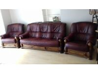 3 seat leather sofa and two armchairs carved wood
