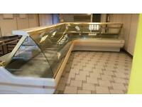 L shape serve over display counter commercial