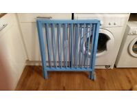 cot in baby blue