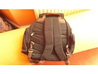 RUCKSACK WITH THICK PADDED STRAPS AND ZIPPED FRONT POCKET AND BACK ZIPPED COMPARTMENT