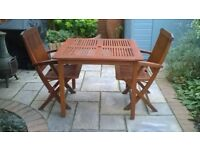 Garden table and chairs-Redwood. Table 1 metre square and 4 armchairs
