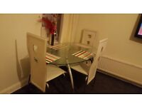 beautiful glass dining table and chairs for quick sale