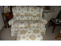 2 seater sofa with matching footstool.VGC. £60 ONO please contact Mick 07974577436