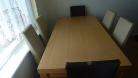 Large dining table comes with 6 chairs