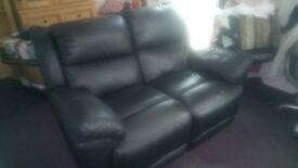 Black leather reclining sofa