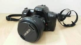 Minolta dynax 303si SLR Camera and accessories