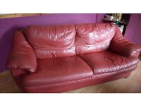 Red learher settee and chair