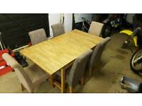 Solid oak extendable table with six chairs