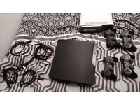 PS3 Slim 500GB with Cables, 4 Controllers and 50 Games