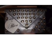 BRAND NEW WITH TAGS LADIES SILVER CLUTCH BAG WITH GOLD/GEM EYELET DETAIL