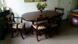 Dining table (extended) + 6 chairs