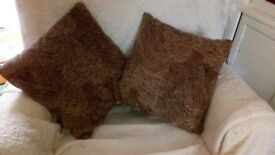 two cushions in tweed type material16 inch square buyer collects