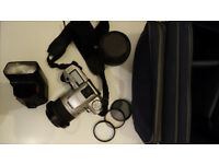 Minolta Dynax 5 SLR with 2 lenses, filters, flash and camera bag