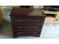 Three drawer bedside cabinet with a chest of drawers and matching headboard