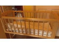 Swinging crib and mobile, and baby rocker