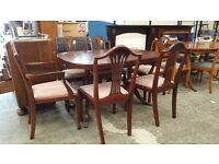 Burgundy extending table with four chairs