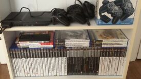 Ps2 with 4 Controllers, 49 Games, Memory Card.
