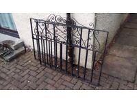 Matching pair of wrought-iron garden gates - black