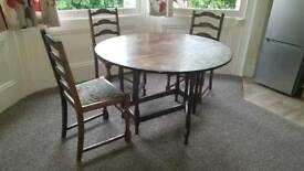 Folding wooden dining table and three chairs for sale