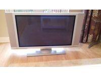 Hitachi 42 inch plasma tv with speakers.