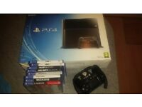 PS4 WITH 8 GAMES IN EXELLENT CONDITION AS RARELY USED,