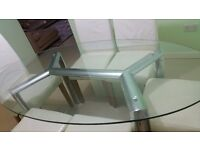 Glass dinning table with leather chairs.