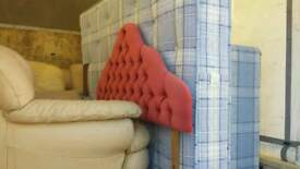 Divan double bed with red headboard
