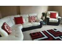 White and black leather corner sofa and electric reclining chair