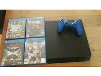 PS4 WITH 8 GAMES AND 13 DLC (BUNDLE)