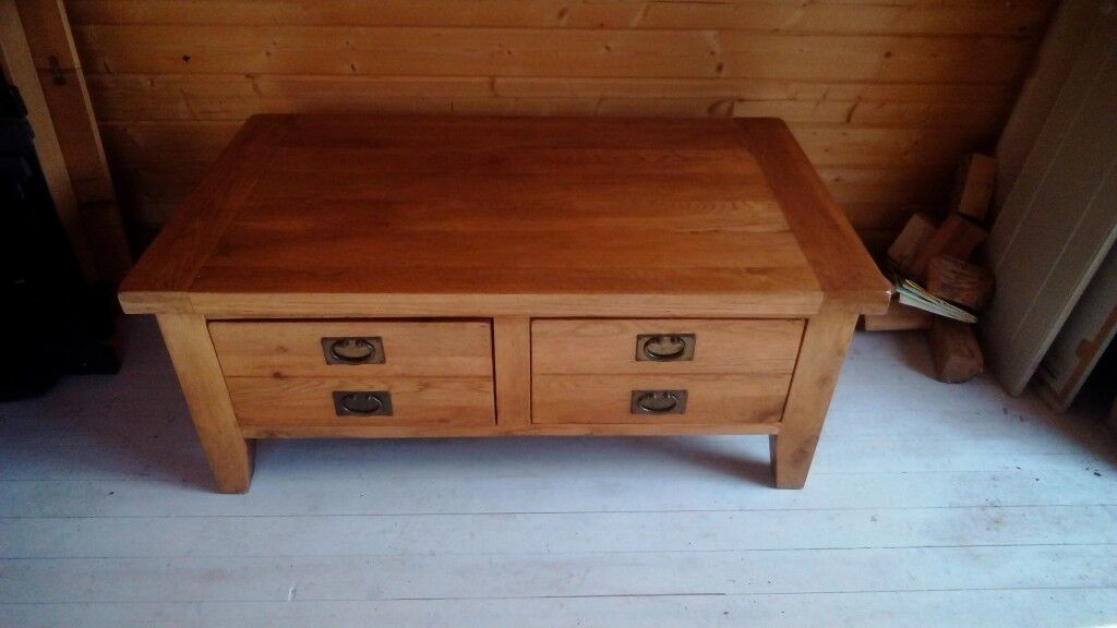 Solid wood coffee table with two drawers.