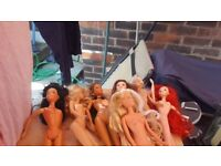 9 assorted Barbie Dolls