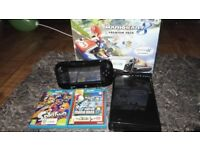 Wii u with a few games great condition comes with a box