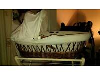 Moses Basket and 2 stands with brand new pack of sheets
