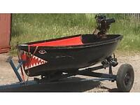 Boat with engine and trailer