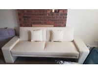 Creme coloured leather 2 seater sofa in good condition