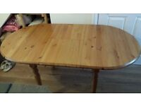 Extendable pine dining table and four chairs