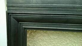 Period cast iron fireplace with wooden dark mantel